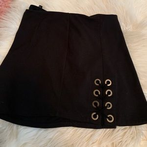 Black Skirt with Stylish Grommets